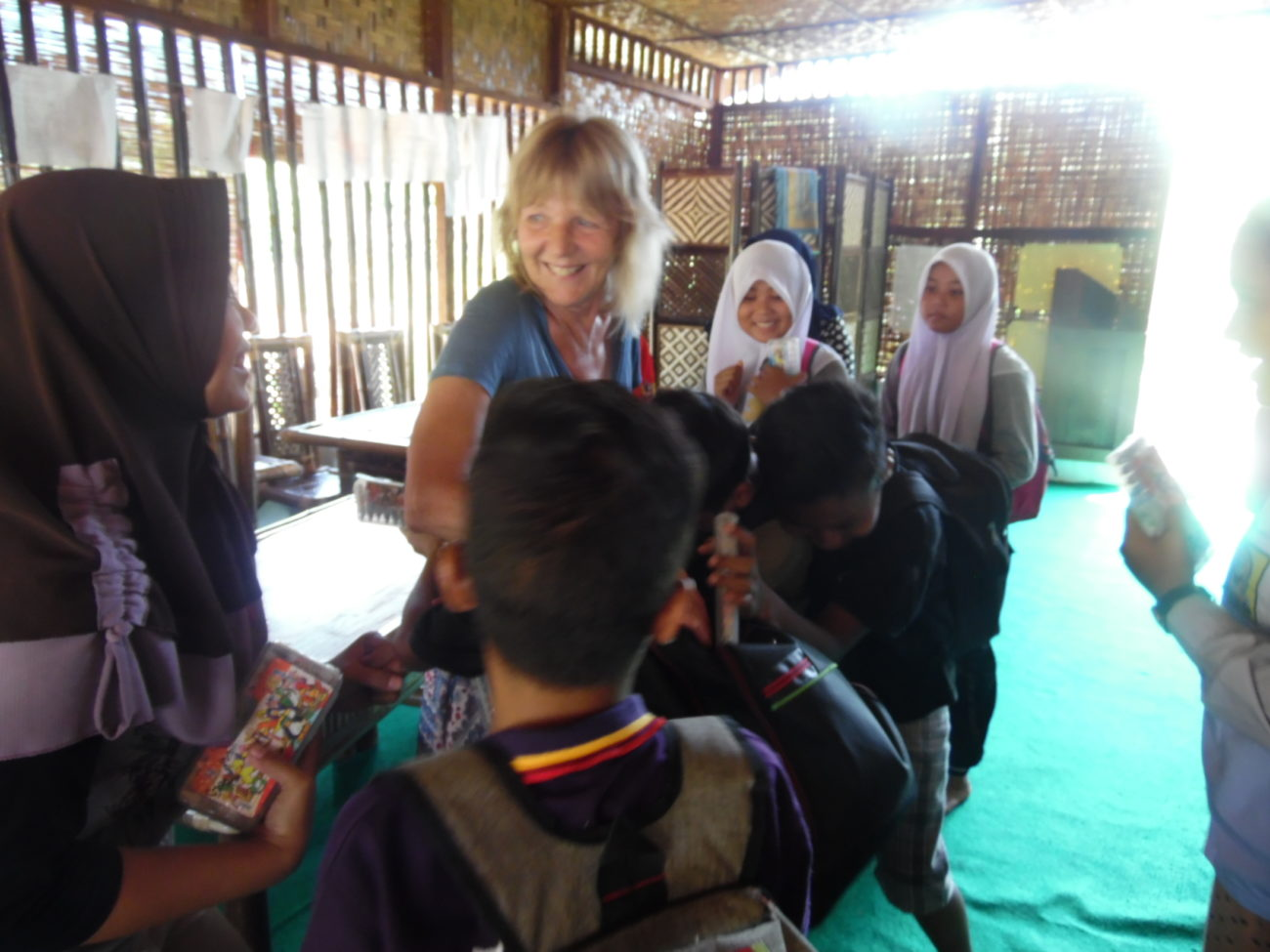 A teacher and pupils in a classroom in Sumatra.